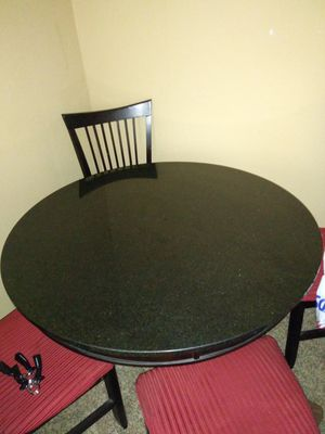 Solid black marble tabe with 4 black and red chairs(if you want the chairs). for Sale in Vancouver, WA