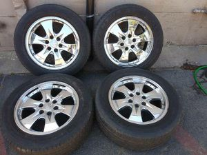 Cadillac 20 inch stock rims with tires for Sale in Montebello, CA