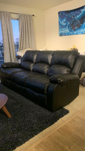 Black leather reclining couch for Sale in Seal Beach, CA