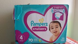 Pampers cruisers size #4 has 70 $20 or trade for 2 enfamil cans box is damaged but diapers bags sealed for Sale in Perris, CA
