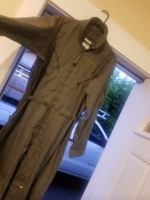 Military coveralls....pants ...jacket ...shirts ...rain poncho and duffle bag. for Sale in Puyallup, WA