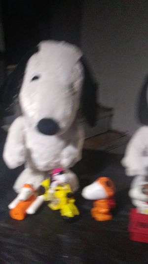 Removing action Snoopy dogs in five little figures that you see in the picture all comes with it all for $20 for Sale in Columbus, OH