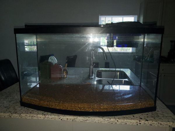Used 30 to 40 gallon tank..no leaks... recently brought LED lights that can be adjusted for brightness or just blue lights.. and working filter