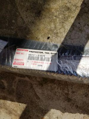 Brand new,still in plastic!Genuine Toyota Tacoma (65717-04020) Tailgate Protector, for Sale in Gresham, OR