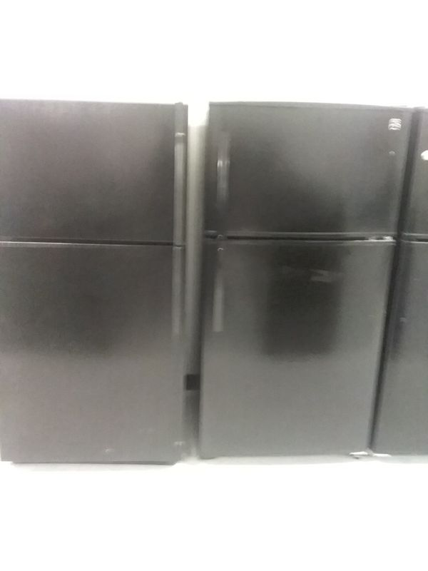 Kenmore, he top and bottom refrigerator used good condition 90days warranty staring 275