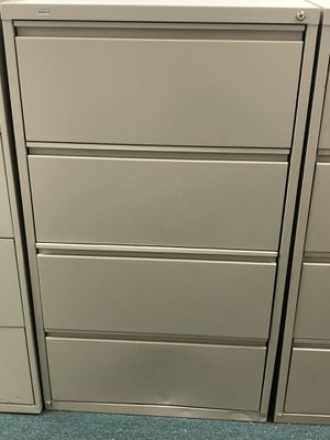 Real space used 4 drawer horizontal file cabinet. Minor dent in bottom but works fine , putty color. for Sale in West Palm Beach, FL