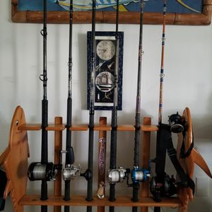Fisherman's dream set includes Everything You See and oak blue fin tuna a rod holders and the custom painted wall mount Holders rod and Reel for Sale in Calabasas, CA