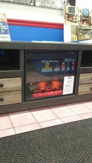 Ashley large tv stand with fireplace option for Sale in Uniontown, PA