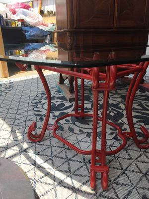 Beveled glass top table in sunset red metal base for Sale in St. Petersburg, FL