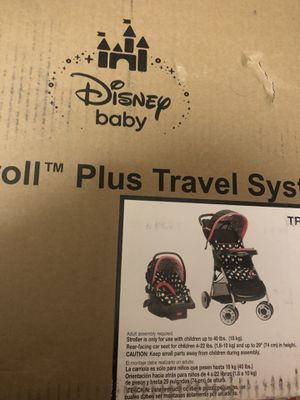 BRAND NEW! Disney Baby Minnie Mouse Lift and Stroll Plus Travel System, Minnie Coral Flowers   MODEL: TR308CFTX for Sale in Gaithersburg, MD
