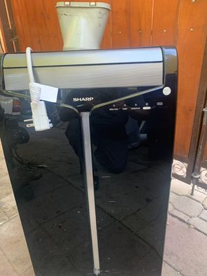 Sharp portable air conditioner 10,000 btu. In good working conditions with remote control for Sale in South Gate, CA