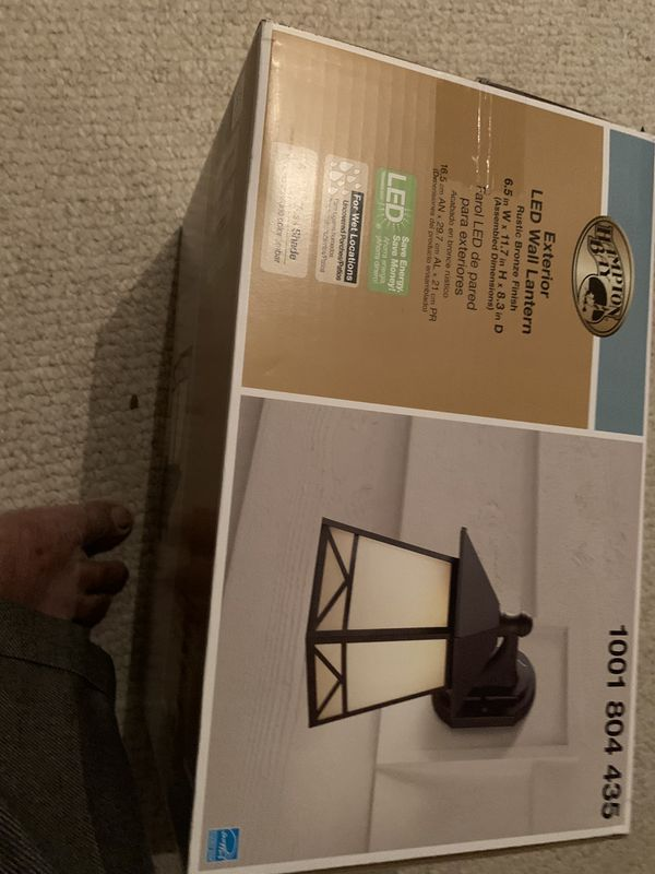 "Price Reduced - Brand New 6.5"" W x 11.7"" H x 8.3"" D Hampton Bay Exterior LED Wall Lantern with Amber Glass Shade"