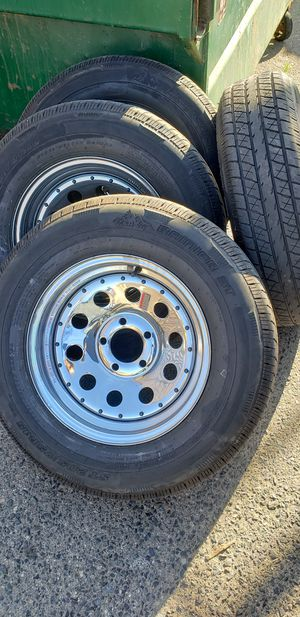 4 Like New Used 5 lug 5x4.5 Chrome Trailer Wheels/Rims 205/75/15 R15 inch radial tires for Sale in Moreno Valley, CA