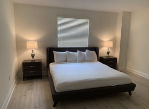 King size bed with mattress and 2 nightstands. Lamps included. for Sale in Miami, FL