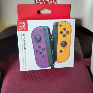 Joy-Con (L/R) Wireless Controllers for Nintendo Switch - Neon Purple/Neon Orange. for Sale in San Lorenzo, CA