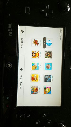 Wii u 32gb with 10 games, 2 controllers and a wii remote. for Sale in Alexandria, VA