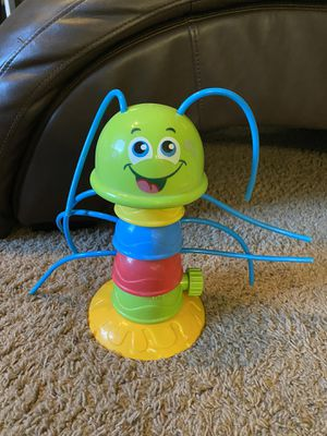 Wiggly catapillar kid's sprinkler in good working condition. Had a small flaw at base but doesn't affect the functionality (see last pic) Fun for ki for Sale in Waddell, AZ