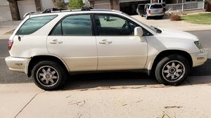 1999 lexus rx 300 condition: excellent cylinders: 6 cylinders drive: 4wd fuel: gas paint color: white size: mid-size title status: clean tra for Sale in Severance, CO