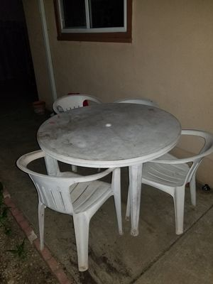 Plastic table with 4 chairs for Sale in Hayward, CA