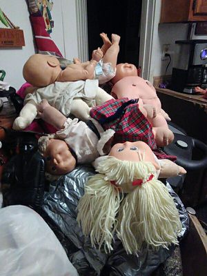 Got a lot lot of cabbage patch dolls in a lot lot of clothes in shoes abox 2 big trash bags full for Sale in Millville, NJ