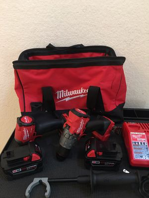 NEW MILWAUKEE M18 FUEL BRUSHLESS HAMMER DRILL/ IMPACT DRIVER KIT (2) BATTERIES/ CHARGER for Sale in Spring, TX