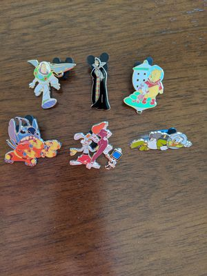 Disney pins limited edition of 1000. Six pins total including Stitch, Rodger rabbit and Jessica, Donald duck, Buzz, evil Queen and Winnie the Pooh for Sale in Glendale, AZ