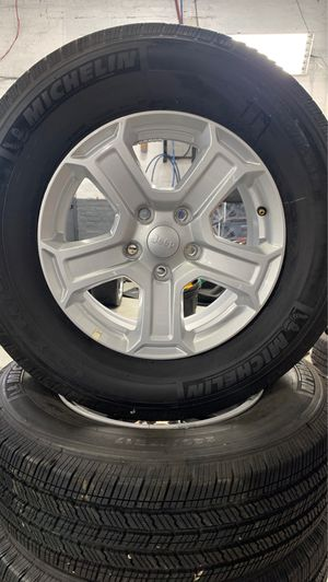 "17"" Jeep Wrangler rims and tires LIKE NEW for Sale in Melrose Park, IL"