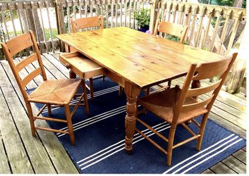 Knotty -Pine Dining Table with center drawer, 2 Attachable Leaves, and 4 Ethan Allen Ladder Back Chairs with Rush Seats for Sale in Great Neck,  NY