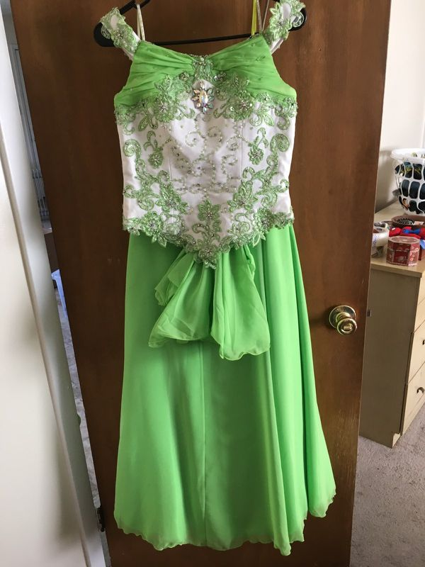 Formal dresses. Each worn once. Sizes child 12- adult 6.