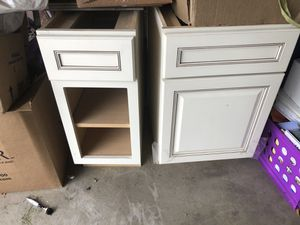 Kraftmaid cabinets. Off white. Cinnamon piping. Left cabinet does have a door. In a separate box. $100 for both. for Sale in Centennial, CO