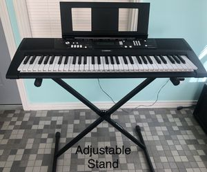 Yamaha EZ-220 Keyboard, Stand, Bench, Books and Phillips Headphones for Sale in Fulton, MS