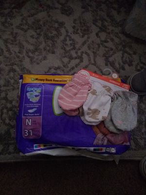 Newborn mittens and diapers . I will also throw in open new born and size one. for Sale in Redlands, CA