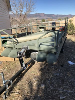 Double pontoon and 15 horse mercury for Sale in Colorado Springs, CO