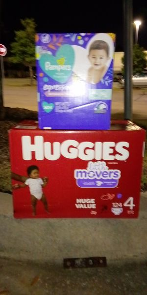 Brand New case of Huggies little movers size 4 comes with a huge case of pampers wipes! for Sale in Spring, TX