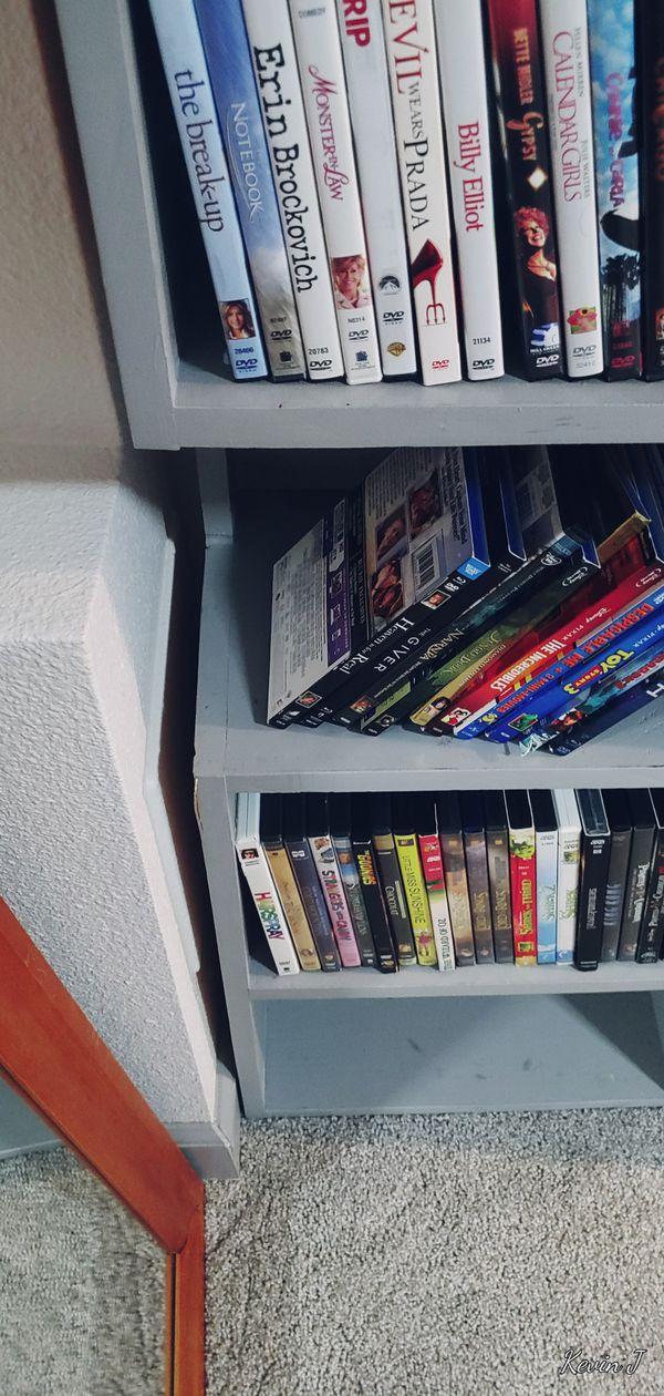 Grey wooden movie shelf plus all movies