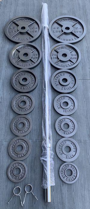 Olympic Weights/7ft Bar (2x45) (2x35) (2x25) (2x10) (4x5) (2x2.5) for Sale in Riverside, CA