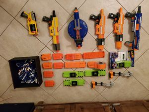 6 Nerf Guns with 15 Cartridges and Darts for Sale in Houston, TX
