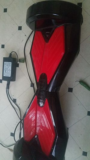 Hoverboard with charger for Sale in Dallas, TX
