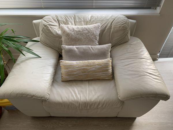 White Leather Chair, Plush rug, Arm Chair, and Ottoman