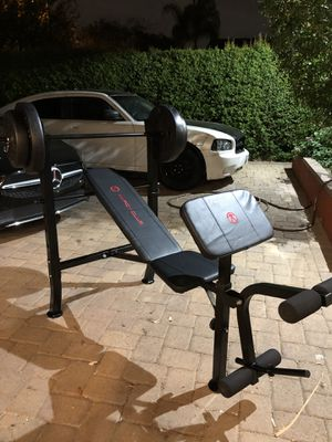 Gym Equipment Adjustable Bench press, barbell, leg developer and 80lbs of weight for Sale in Montebello, CA