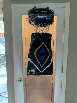HAMPER HOOPS FOR KIDS!! HANGS OVER THE DOOR! KIDS TOSS CLOTHES IN THE HOOP! BAG HAS ZIPPER ON BOTTOM TO RELEASE DIRTY ITEMS!! CLEAN LIKE NEW for Sale in Modesto, CA
