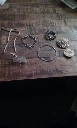 Simulated diamonds, hard rock pin, black studded earring, gold bracelet and silver bracelet for Sale in Greenfield, WI