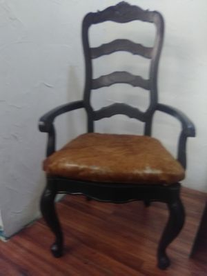 Cowhide armed chair for Sale in WHT SETTLEMT, TX