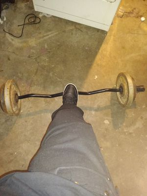 Curl bar 2/25lb plates..2/15lb plates and 2/10lb Plates bar is 45lbs for Sale in Detroit, MI