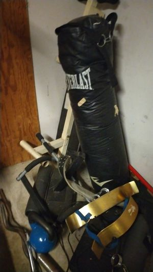 Workout equipment..two preacher curl plates that wrap around neck.. heavy bag..curl bar.. for Sale in Lavon, TX