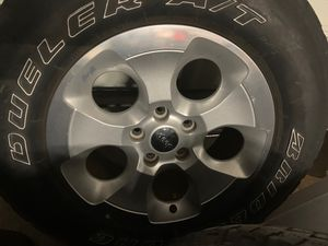 Jeep Wrangler Sahara rims wheels w/ tires. 18 inch. All 5 for Sale in Hialeah, FL