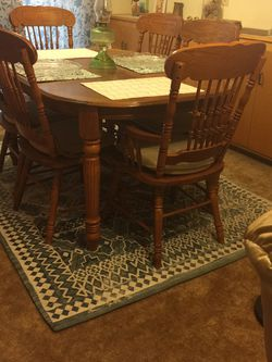 Solid Red Oak Dinning Set(like new)top 42by 60/H 30/ with Extension Top Is 78 inches.Chairs: 2 Captain & 4 Side. for Sale in Riverside,  CA