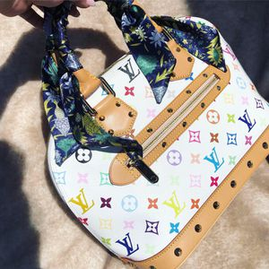 Authentic Louis Vuitton Alma PM white multi colored handbag with dust bag for Sale in Sacramento, CA