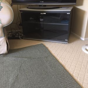 45$ For Tv Cart With Glass Door for Sale in Redlands, CA