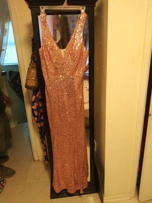 Nice party rose Gold dress size 11 it also stretches for Sale in San Antonio, TX